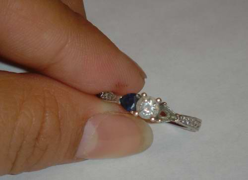 The sapphire fell out of my ring again!  I swear it wasn't my fault!